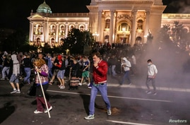 Demonstrators take part in a protest against a lockdown planned for the capital this weekend to halt the spread of the…