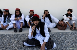 FILE PHOTO: Newly freed Taliban prisoners sit at Pul-i-Charkhi prison, in Kabul, Afghanistan May 26, 2020. REUTERS/Mohammad…