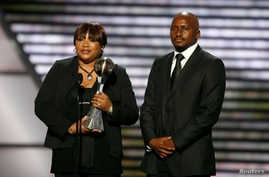 FILE PHOTO: Nelson Mandela's daughter, Zindzi Mandela, and grandson, Zondwa Mandela, accept the Arthur Ashe Courage Award on…