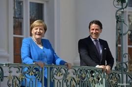 German Chancellor Angela Merkel welcomes Italian Prime Minister Giuseppe Conte before a meeting  at the German governmental…