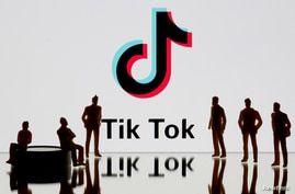 FILE - A 3-D printed figures are seen in front of displayed Tik Tok logo in this picture illustration taken Nov. 7, 2019.