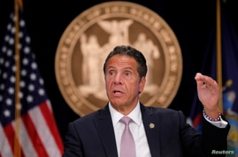 FILE PHOTO: New York Governor Andrew Cuomo speaks during a daily briefing following the outbreak of the coronavirus disease …
