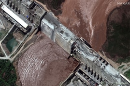 FILE PHOTO: A handout satellite image shows a closeup view of the Grand Ethiopian Renaissance Dam (GERD) and the Blue Nile…