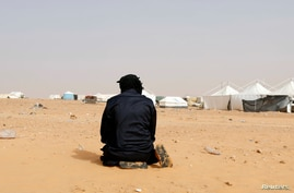 FILE PHOTO: A Tunisian protester prays during a sit-in at El Kamour oilfield, demanding jobs and a share in revenue from the…