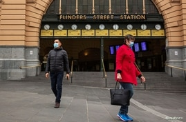 People are seen outside of Flinders Street Station amidst a lockdown in response to an outbreak of the coronavirus disease (COVID-19) in Melbourne, July 17, 2020.
