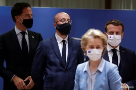 Dutch Prime Minister Mark Rutte, European Council President Charles Michel, French President Emmanuel Macron