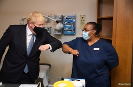 Britain's Prime Minister Boris Johnson visits the Tollgate Medical Centre in Beckton, London, Britain July 24, 2020. Jeremy…