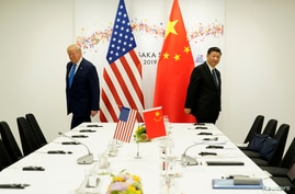 FILE PHOTO: U.S. President Donald Trump attends a bilateral meeting with China's President Xi Jinping during the G20 leaders…