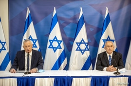 Israeli Prime Minister Benjamin Netanyahu issues a statement at the Israeli Defense Ministry in Tel Aviv, Israel with the …