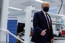 U.S. President Donald Trump gestures during a tour of the Fujifilm Diosynth Biotechnologies' Innovation Center, a…
