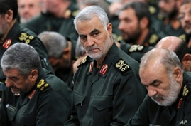 FILE - Qassem Soleimani, center, attends a meeting in Tehran, Iran.
