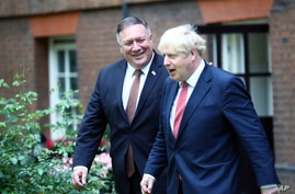 Britain's Prime Minister Boris Johnson, right, welcomes US of State, Mike Pompeo to Downing Street.