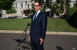 Treasury Secretary Steven Mnuchin speaks with reporters about the coronavirus relief package negotiations, at the White House, July 23, 2020, in Washington.