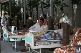 Patients are connected to oxygen tanks at the Afghan-Japan Communicable Disease Hospital, for COVID-19 patients in Kabul, Afghanistan, June 18, 2020.