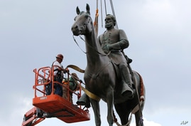 Work crews remove the statue of confederate general Stonewall Jackson, July 1, 2020, in Richmond, Virginia. Richmond Mayor Levar Stoney has ordered the immediate removal of all Confederate statues in the city.