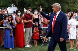 "President Donald Trump greets visitors as he walks on the South Lawn of the White House during a ""Salute to America"" event,…"