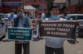 Kashmiri journalists hold placards during a protest against a new media policy that was announced last month in Srinagar,…