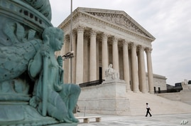 A police officer walks outside the Supreme Court on Capitol Hill in Washington, Monday, July 6, 2020. (AP Photo/Patrick…