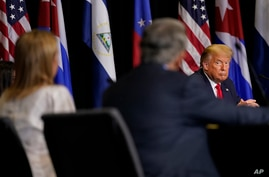President Donald Trump listens during a roundtable on Venezuela at Iglesia Doral Jesus Worship Center, Friday, July 10, 2020,…