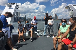 Photo by: STRF/STAR MAX/IPx 2020 7/12/20 Ferry Riders are seen during the Coronavirus Pandemic in New York City.