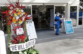 A flower arrangement is seen at an entrance of Jackson Memorial Hospital in Miami.