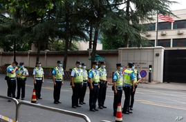 Chinese police officers form up in front of the United States Consulate in Chengdu in southwestern China's Sichuan province, July 25, 2020.