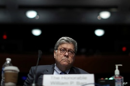 Attorney General William Barr listens during a House Judiciary Committee hearing on the oversight of the Department of Justice.
