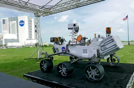 A replica of the Mars rover Perseverance is displayed outside the press site before a news conference at the Kennedy Space…