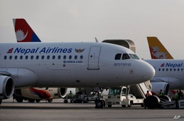 Nepal Airlines Airbus 320 and other international airlines are seen parked inside Tribhuwan International airport in Kathmandu,…