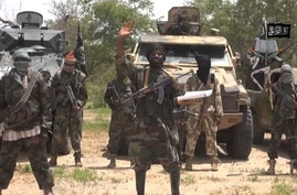 A screengrab taken on July 13, 2014 from a video released by the Nigerian Islamist extremist group Boko Haram and obtained by…
