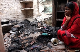 Hena Tabassum, 20, at her house in Telinipara, two days after it was violently attacked by a Hindu mob during communal violence. The attackers threw Molotov cocktails to set it on fire and used a gas cylinder to trigger a big explosion. (Alex Simon/VOA)