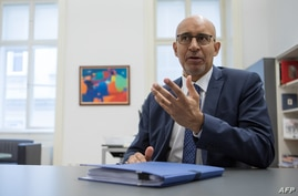 FILE - Harlem Desir, OSCE Representative on Freedom of the Media, speaks during an interview in Vienna, Austria, June 3, 2020.