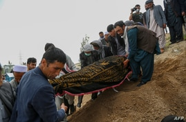 Mourners carFILE - Mourners carry a covered body during a burial ceremony following a suicide attack on a hospital, at a cemetery in Kabul, Afghanistan, May 13, 2020. ry a covered dead body during a burial ceremony following a suicide attack in a maternity hospital, at a cemetery…