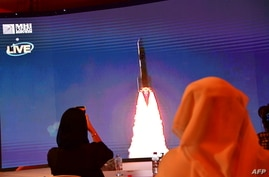 "A picture taken July 19, 2020, shows a screen broadcasting the launch of the ""Hope"" Mars probe at the Mohammed Bin Rashid Space Centre in Dubai, United Arab Emirates."