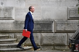 FILE - Britain's Foreign Secretary Dominic Raab leaves the Foreign and Commonwealth Office in central London, July 1, 2020.
