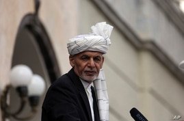 FILE - Afghan President Ashraf Ghani speaks after he was sworn in at an inauguration ceremony at the presidential palace in Kabul, March 9, 2020.