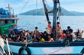 In this handout photo released on April 5, 2020 by the Malaysian Maritime Enforcement Agency, a wooden boat carries suspected Rohingya migrants detained in Malaysian territorial waters off the island of Langkawi.