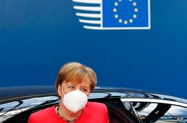 German Chancellor Angela Merkel wears a protective face mask as she arrives for the continuation of an EU summit meeting in Brussels, Belgium, July 20, 2020.