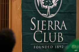 FILE - A Sierra Club sign is seen at a news conference held by the Environmental Priorities Coalition, in Olympia, Washington, Feb. 15, 2011.