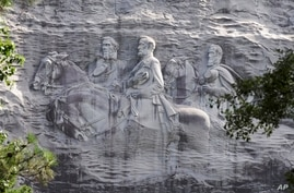 FILE - A carving in stone depicting Confederate Civil War figures Stonewall Jackson, Robert E. Lee and Jefferson Davis, in Stone Mountain, Georgia, June 23, 2015. The sculpture is America's largest Confederate memorial.