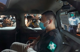 Tong Ying-kit, 23, arrives at a court in a police van in Hong Kong, July 6, 2020.