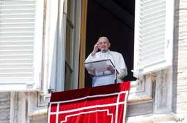 Pope Francis waves to faithful from his studio window overlooking St. Peter's Square at the Vatican, as he leaves at the end of the Angelus prayer, July 5, 2020.