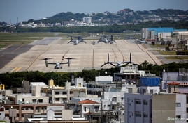 FILE - U.S. Marine Corps MV-22 Osprey aircrafts are seen at the U.S. Marine Corps' Futenma Air Station in Ginowan on Japan's southernmost island of Okinawa, March 24, 2018.