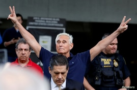 FILE - Long-time friend of President Donald Trump Roger Stone flashes victory signs after his appearance at Federal Court in Fort Lauderdale, Florida, Jan. 25, 2019.