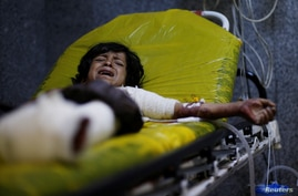 A boy, 12, cries as he lies on a stretcher at a hospital in Sanaa to which he was rushed after he was injured in an airstrike in the northern province of al-Jawf, Yemen, July 15, 2020.