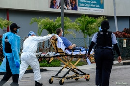 Emergency Medical Technicians (EMT) arrive with a correctional patient at North Shore Medical Center where the coronavirus disease (COVID-19) patients are treated, in Miami, Florida, July 14, 2020.