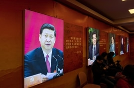 An image of China's President Xi Jinping is seen on an exhibition about history of the Communist Party of China (CPC) in…