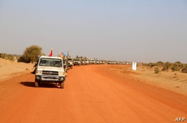 A convoy of vehicles of the Coalition of the People of Azawad (CPA) are seen driving while patrolling the area near the Mali…