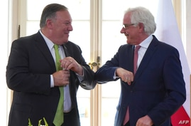 US Secretary of State Mike Pompeo and Polish Foreign Minister Jacek Czaputowicz greet each other with an elbow bump as they…