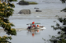 A Chinese boat with a team of geologists surveys the Mekong River, at the border between Laos and Thailand April 23, 2017…